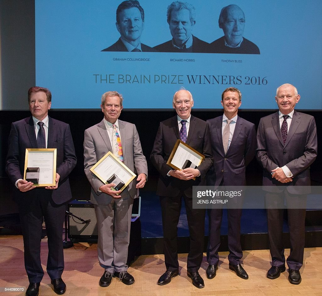 Danish Crown Prince Frederik (2R)and Chairman of the Brain Prize Foundation, Povl Krogsgaard-Larsen stand next to laureates (L to R) Professor of the Department of Physiology at the University of Toronto Graham Collingridge, Professor of Neuroscience at the University of Edinburgh Richard Morris and scientist Timothy Bliss during the awarding ceremony in Copenhagen July 1, 2016. The Brain Prize is awarded to one or more scientists who have distinguished themselves by an outstanding contribution to European neuroscience and who are still active in research. / AFP / Scanpix Denmark AND Scanpix / Jens Astrup / Denmark OUT