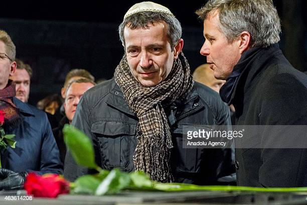 Danish Crown Prince Frederik and Chairman of The Jewish Community Dan Rosenberg Asmussen attend a memorial service for the shooting victims near...