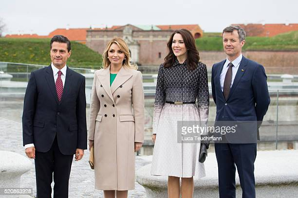 Danish Crown Prince Frederik and Crown Crown Princess Mary of Denmark greet Mexican President Enrique Pena Nieto and his wife Angelica Rivera during...