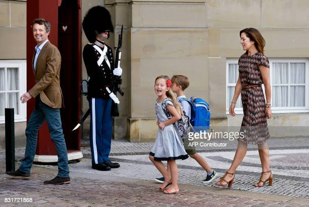 Danish Crown Prince Frederik and Crown Princess Mary are pictured with their twins Prince Vincent and Princess Josephine in front of Amalienborg...
