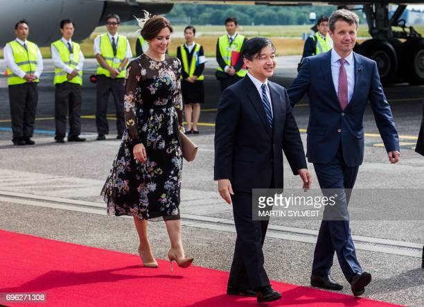 Danish Crown Prince Frederik and Danish Crown Princess Mary welcome Japan's Crown Prince Nahurito during a welcoming ceremony in Copenhagen Airport...