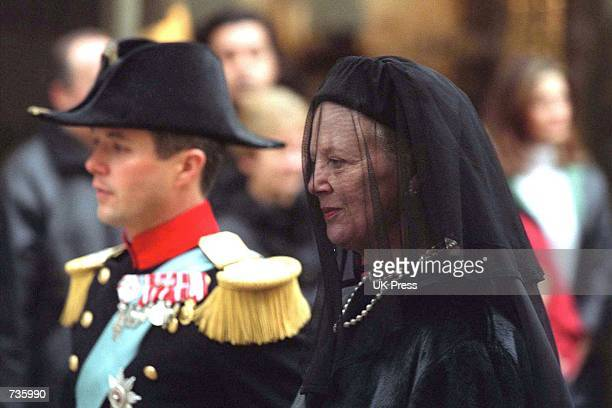Danish Crown Prince Frederik and Queen Margrethe walk behind Danish Queen Mother Ingrid's coffin towards Copenhagen's central station during a...