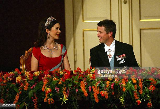 Danish Crown Prince Frederik looks at his Australian Mary Donaldson fiance during the galla performance in The Royal Theatre in Copenhagen 13 May...