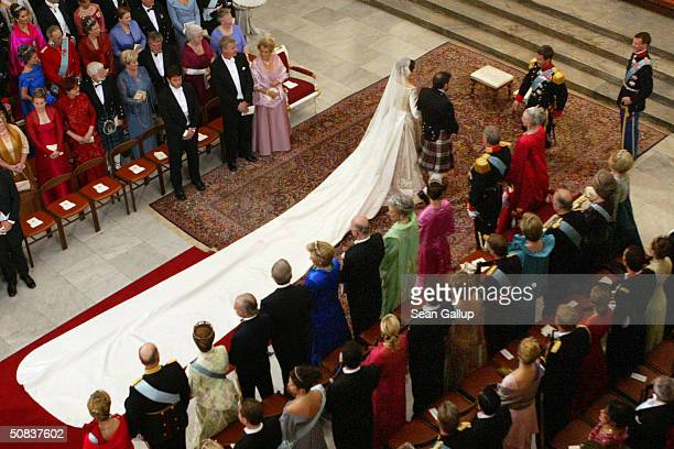 Danish Crown Prince Frederik looks on as his bride Mary Donaldson walk down the isle with her father Dr John Donaldson copenhagen Cathedral May 14...