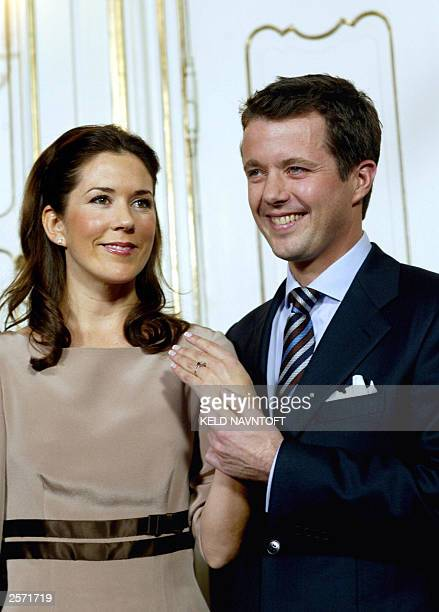Danish Crown Prince Frederik shows the engagement ring on the hand of his fiancee Mary Donaldson of Australia 08 October 2003 during their first...