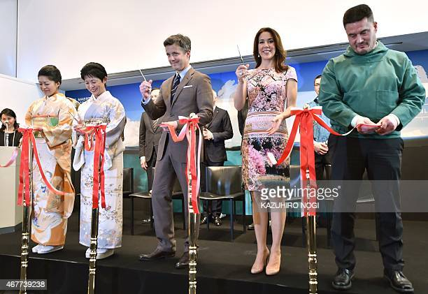 Danish Crown princess Mary and Crown Prince Frederik participate in a tape cutting ceremony as part of the official opening of the exhibition about...