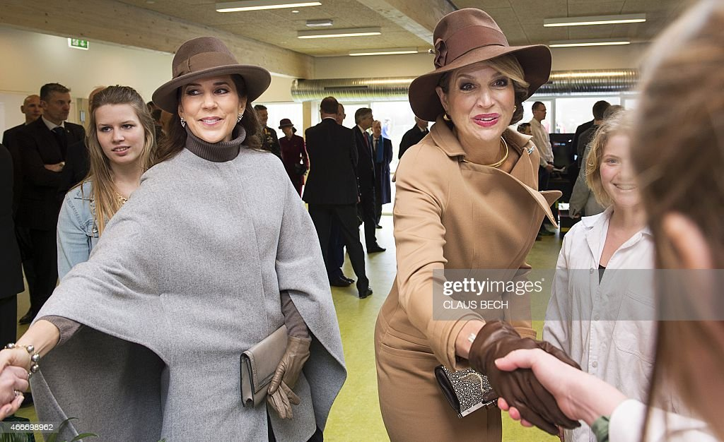 Danish Crown Princess Mary (L) and the Dutch Queen Maxima (L) visit a continuation school at the island Samsoe, Denmark, on March 18, 2015. The Dutch royal couple is on two-day state visit in Denmark.