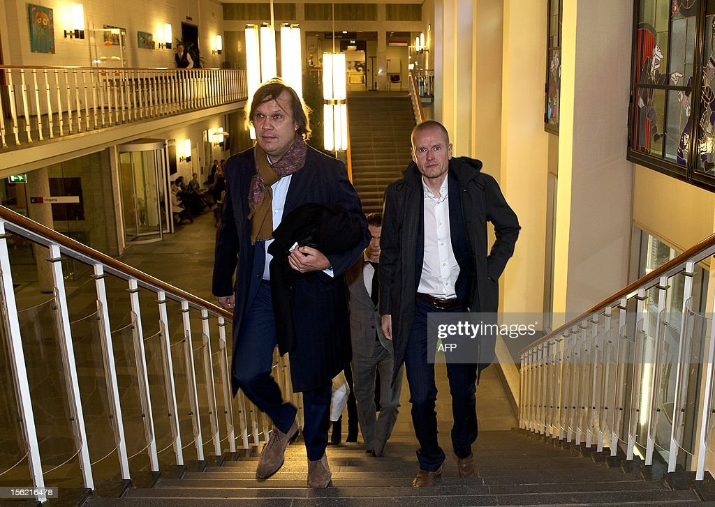 Danish cyclist Michael Rasmussen (R) and his lawyer Andre Brantjes arrive at Arnhem's courtroom on November 12, 2012, at the beginning of his appeal against his former cycling team Rabobank. Rasmussen claims damages after he was thrown off the 2007 Tour de France by his team while wearing the leader's yellow jersey for lying about his whereabouts the previous month when he was being sought out for doping tests, and was subsequently banned by the UCI. AFP PHOTO / ANP / JERRY LAMPEN netherlands out