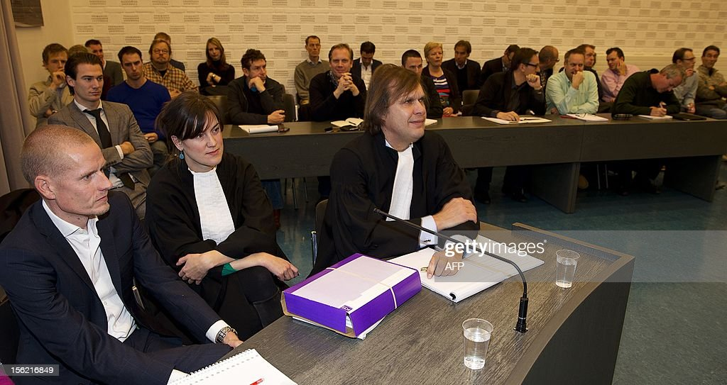 Danish cyclist Michael Rasmussen (L) and his lawyers sit in he courtroom of Arnhem, The Netherlands, on November 21, 2012 at the beginning of the appeal between him and the Rabobank cycling team. Rasmussen is claiming damages of 5.8 million in a case that revolves around the dismissal of the Danish cyclist in the Tour de France of 2007. AFP PHOTO / ANP JERRY LAMPEN = netherlands out