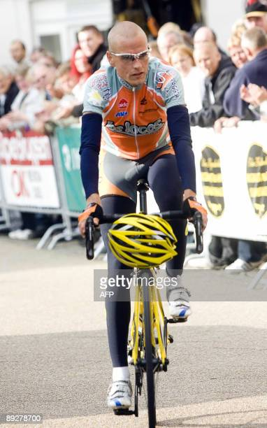 Danish cyclist Michael Rasmussen awaits the start of the Designa Grand Prix race on July 27 2009 in the small town of Kjellerup in Jutland Denmark...