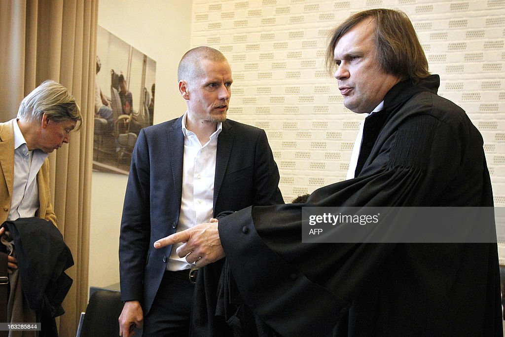 Danish cyclist Michael Rasmussen (C), flanked by witness Jan-Paul Van Mantgemon (L) listens to his lawyer Andre Brantjes (R) in a courtroom before an appel trial in Arnhem, on March 7, 2013. Rasmussen is claiming 5.8 million euros (some 7.55 million US dollars) as damages from his former Rabobank team who dismissed him from the 2007 Tour de France,- when he was wearing the race leader's yellow jersey, after confusion over his whereabouts when it came to anti-doping tests. Rasmussen admitted in January 2013 that he had used banned drugs between 1998-2010. - belgium out