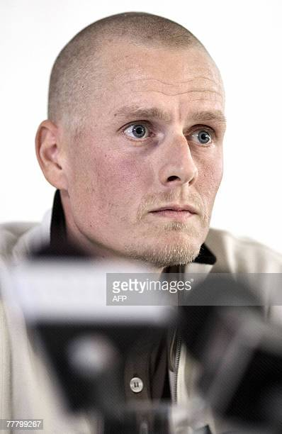 Danish cyclist Michael Rasmussen listens to a question from the media during his press conference in Copenhagen 08 November 2007 AFP PHOTO / SCANPIX...