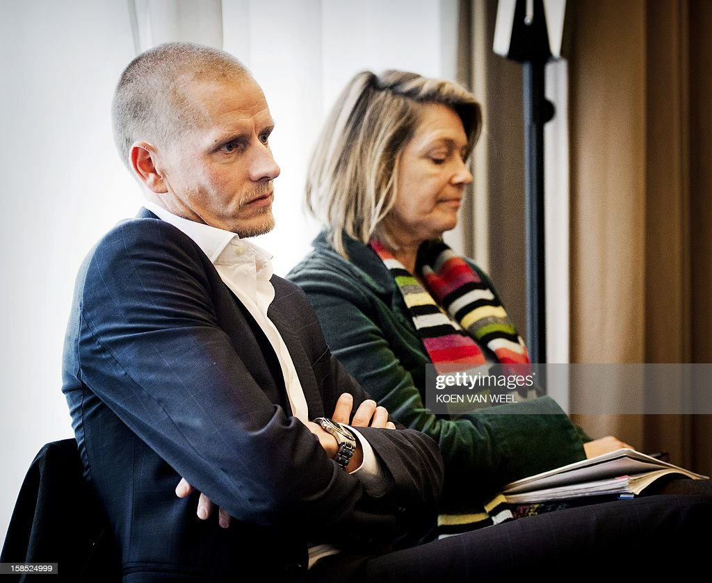 Danish cyclist Michael Rasmussen (L) sits in a courtroom in Arnhem, on December 18, 2012, prior to the start of his trial against the his former team Rabobank. According to media reports Rasmussen is claiming damages of 5.8 million euros from his former Rabobank team who dismissed him from the 2007 Tour de France after confusion over his whereabouts when it came to anti-doping tests. ANP KOEN VAN WEEL