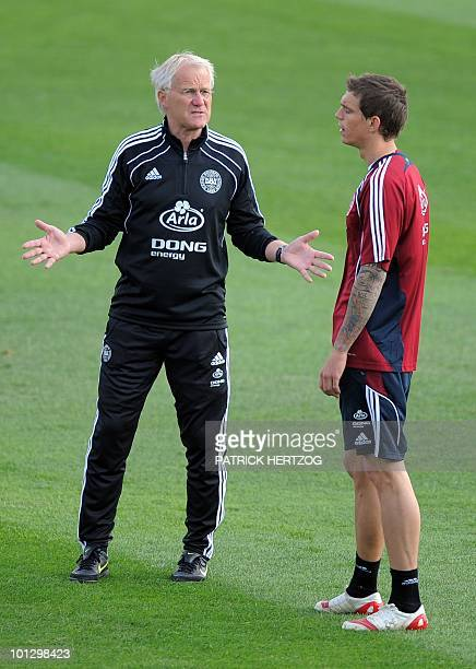 Danish defender Daniel Agger listens to his coach Morten Olsen during a training session at the Football Club in Randburg on May 31 2010 ahead of the...