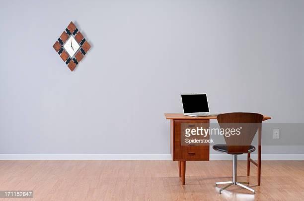 Danish Desk And Laptop In Empty Room.