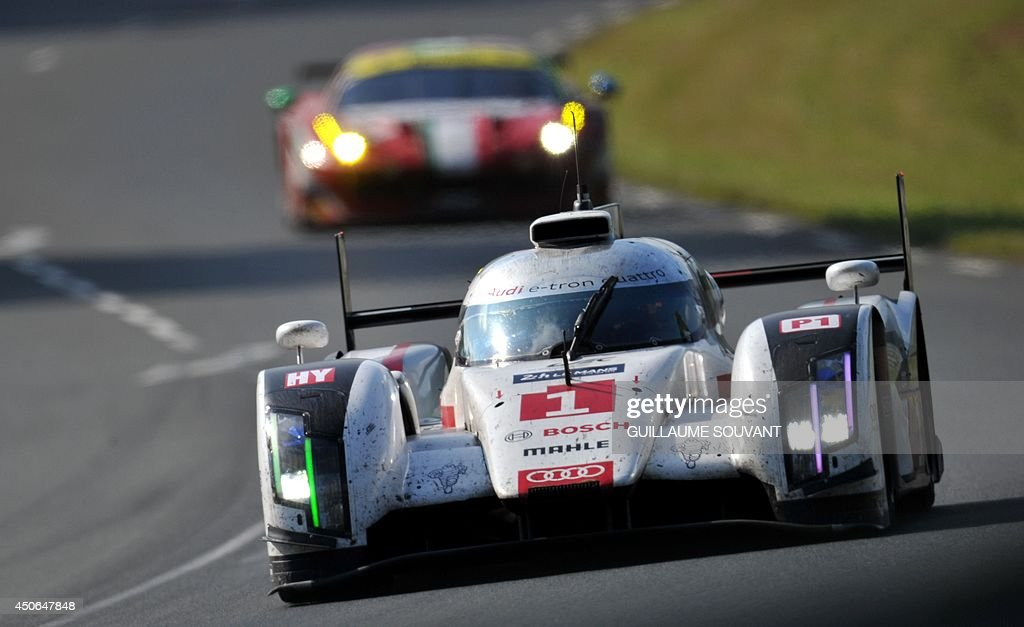 Danish driver Tom Kristensen in his Audi R18 E-Tron Quattro Hybrid N°1 competes during the 82nd Le Mans 24 hours endurance race, on June 15, 2014 in Le Mans, western France. Fifty-six cars with 168 drivers are participating on June 14 and 15 in the Le Mans 24-hours endurance race. AFP PHOTO / GUILLAUME SOUVANT