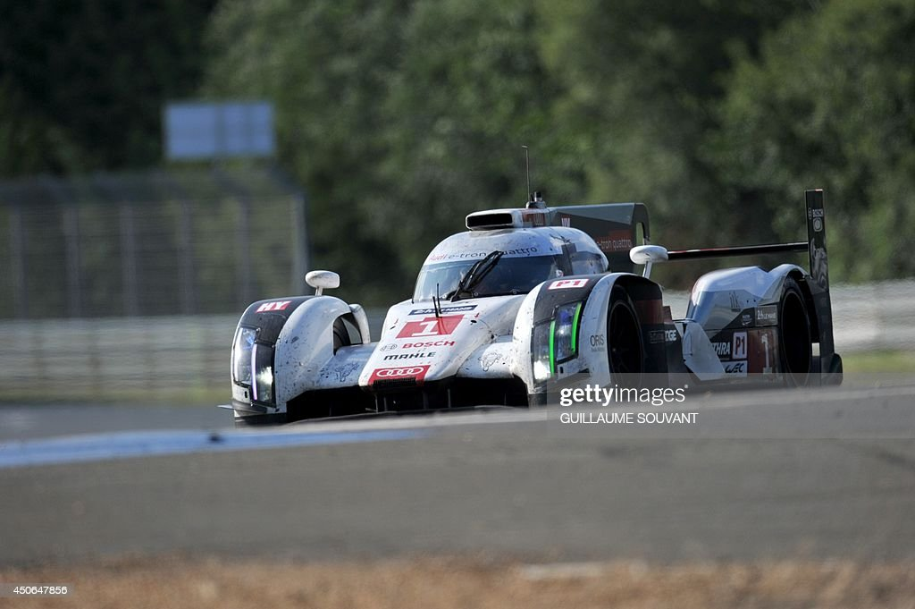 Danish driver Tom Kristensen in his Audi R18 E-Tron Quattro Hybrid N°1 competes during the 82nd Le Mans 24 hours endurance race, on June 15, 2014 in Le Mans, western France. Fifty-six cars with 168 drivers are participating on June 14 and 15 in the Le Mans 24-hours endurance race.