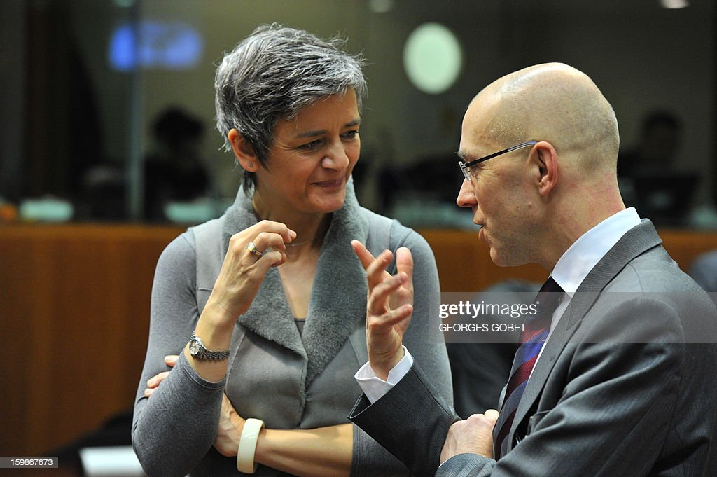 Danish Economy Minister Margrethe Vestager (L) and ECB board member Jorg Asmussen (R) talk on January 22, 2013 before an Economic and Financial Affairs Council at EU headquarters in Brussels. EU finance ministersare expected to approve a financial transactions tax requested by 11 European Union nations.