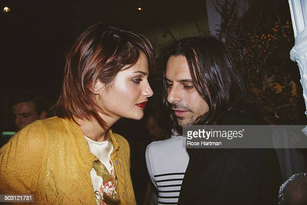 Danish fashion model and photographer Helena Christensen and American photographer Sante D'Orazio attend a Vogue Magazine party 1995