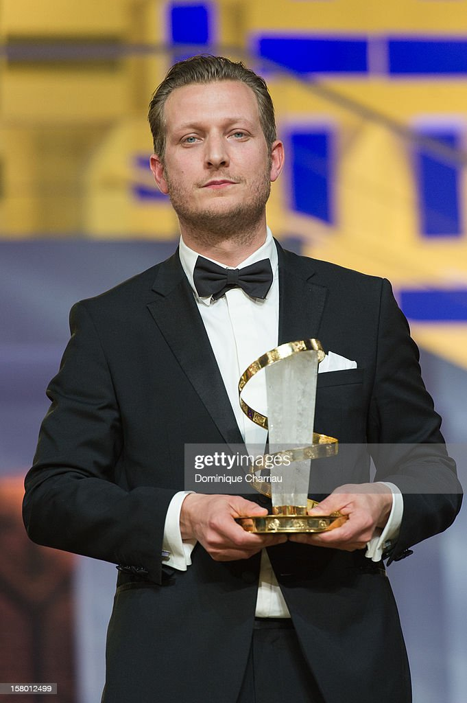Danish film director <a gi-track='captionPersonalityLinkClicked' href=/galleries/search?phrase=Tobias+Lindholm&family=editorial&specificpeople=7058838 ng-click='$event.stopPropagation()'>Tobias Lindholm</a> poses with the Jury prize for the film 'A Hijacking' during the award ceremony of the 12th International Marrakech Film Festival on December 8, 2012 in Marrakech, Morocco.