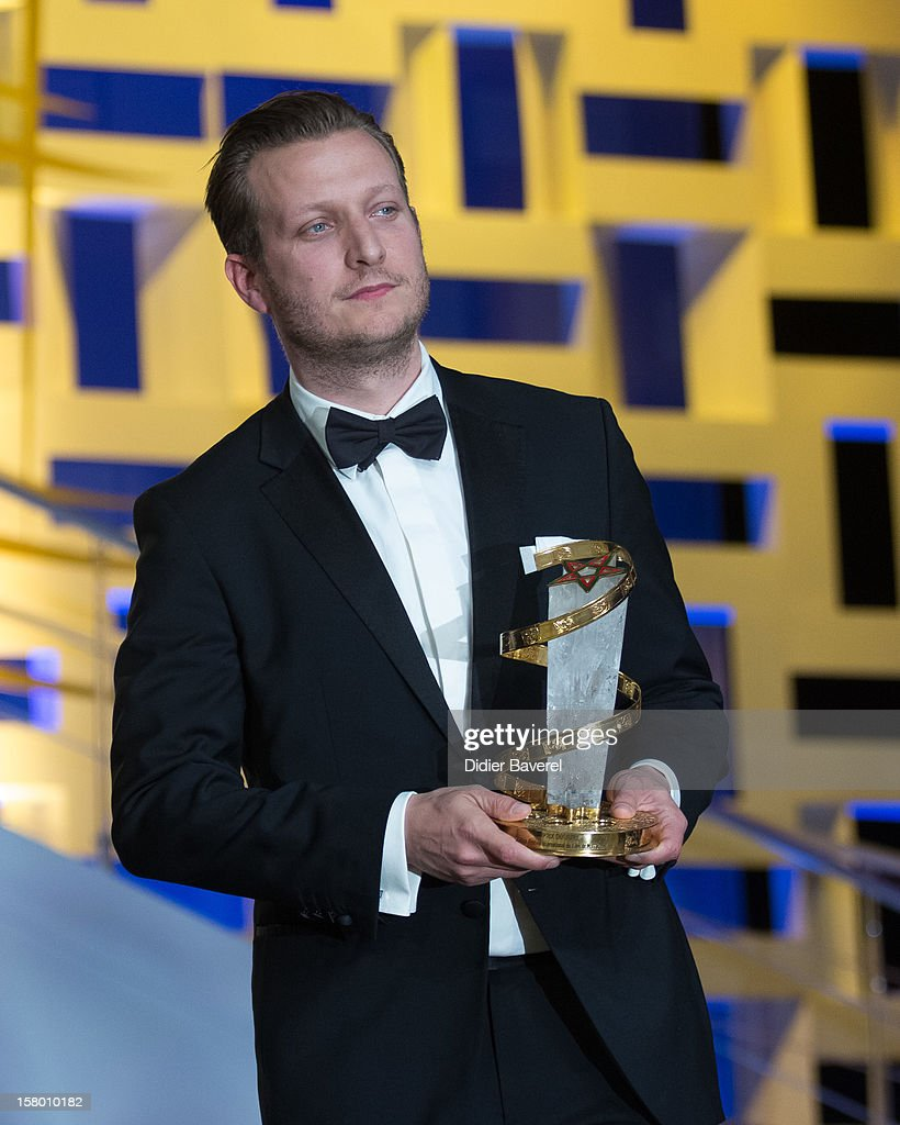 Danish film director <a gi-track='captionPersonalityLinkClicked' href=/galleries/search?phrase=Tobias+Lindholm&family=editorial&specificpeople=7058838 ng-click='$event.stopPropagation()'>Tobias Lindholm</a> wins the Jury Prize award for his film ' A Hijacking' at 12th International Marrakech Film Festival on December 8, 2012 in Marrakech, Morocco.