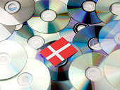 Danish flag on top of CD and DVD pile isolated on white