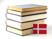 Danish flag with pile of books isolated on white background