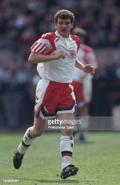 Danish footballer and midfielder with the Denmark national team John Jensen pictured in action during the FIFA World Cup group 3 qualifying match...