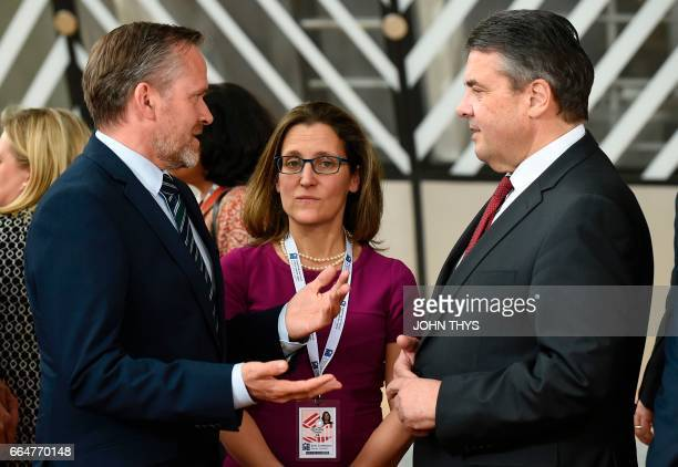 Danish Foreign minister Sanders Samuelson talks with Canadian counterpart Chrystia Freeland and German Foreign Minister Sigmar Gabriel during on...
