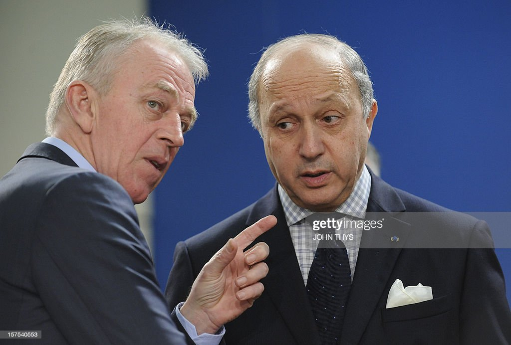 Danish Foreign Minister Villy Sovndal (L) speaks with his French counterpart Laurent Fabius on December 4, 2012 at North Atlantic Treaty Organization (NATO) headquarters in Brussels during a meeting of foreign ministers from the 28 NATO member-countries to discuss Syria and Turkey's request for Patriot missiles to be deployed protectively on the Turkish-Syrian border.