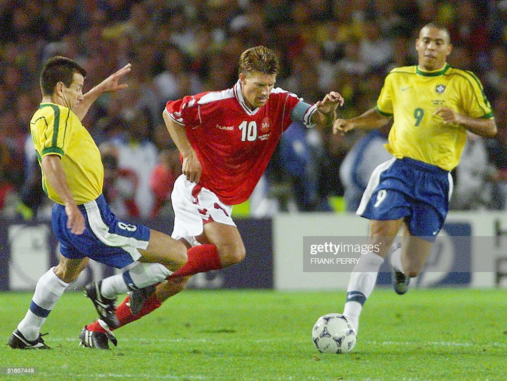Danish forward Michael Laudrup C is challenged b