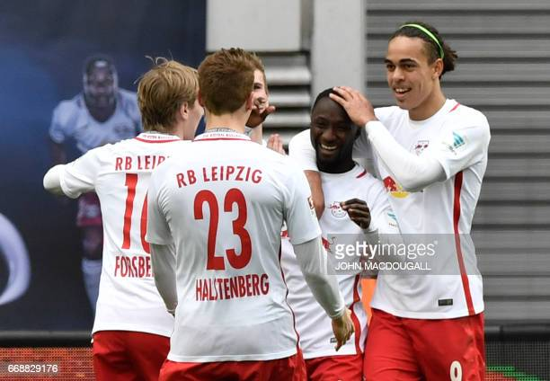 Danish forward Yussuf Poulsen celebrates with Leipzig's Guinean midfielder Naby Keita after Keita scored the third goal during the German First...