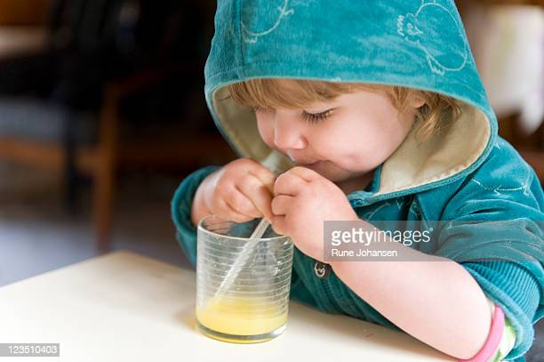 Danish girl, 1 years old, drinking orange juice