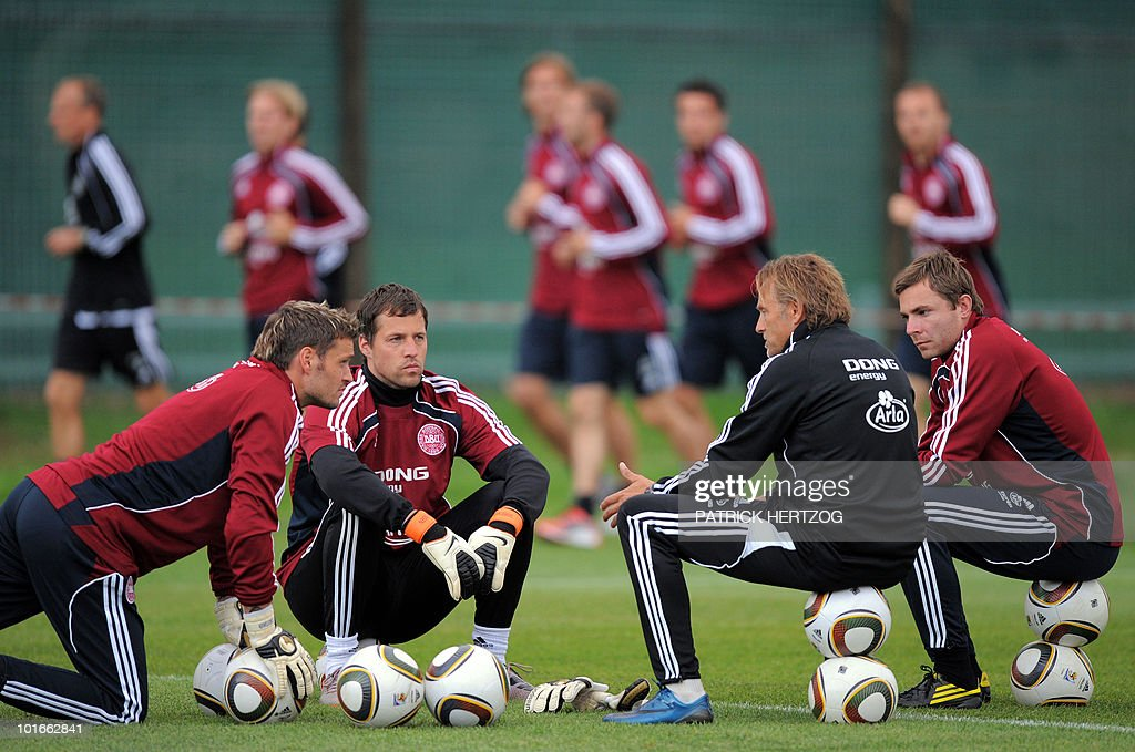 Danish goalkeepers Jesper Christiansen (L), Thomas Sorensen (2nd-L) and Stephan Andersen (R) listen to a coach assistant during a training session at Loerie Park in Knysna on June 6, 2010 ahead of the 2010 World Cup football tournament in South Africa.