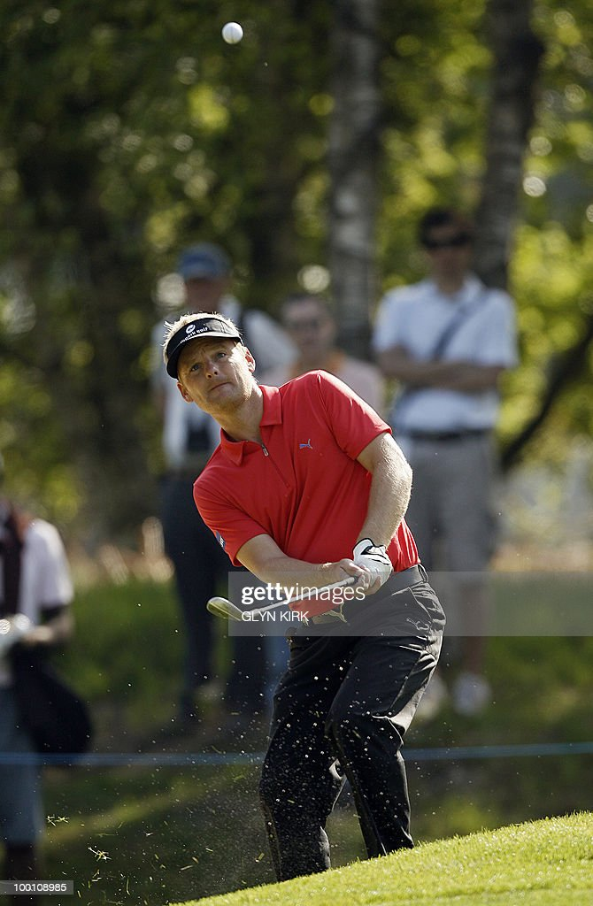 Danish golfer Soren Kjeldsen chips on to the 5th green during the second day of the PGA Championship on the West Course at Wentworth, England, on May 21, 2010.