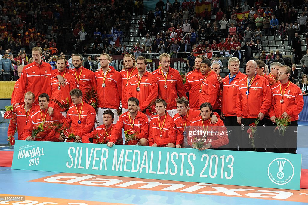 Danish handball team pose with their silver medal on the podium at the end of the 23rd Men's Handball World Championships final match Spain vs Denmark at the Palau Sant Jordi in Barcelona on January 27, 2013. Spain won 35-19. AFP PHOTO/ LLUIS GENE