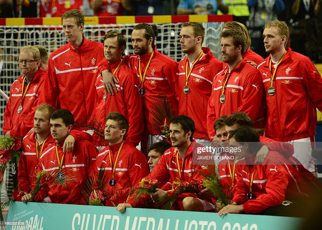 Danish handball team pose with their silver medal on the podium at the end of the 23rd Men's Handball World Championships final match Spain vs Denmark at the Palau Sant Jordi in Barcelona on January 27, 2013. Spain won 35-19.