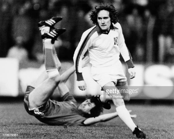 Danish International striker Allan Simonsen of Borussia Monchengladbach leaves a defender on the floor behind him during the UEFA Cup SemiFinal 2nd...