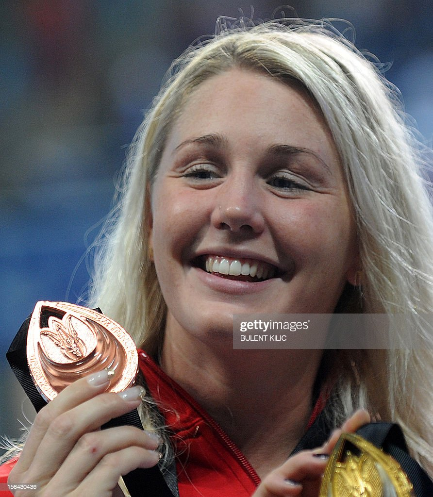 Danish Jeanette Ottesen Gray celebrates her bronze medal after the women`s 50m freestyle final during the Short Course Swimming World Championships in Istanbul on December 16, 2012.