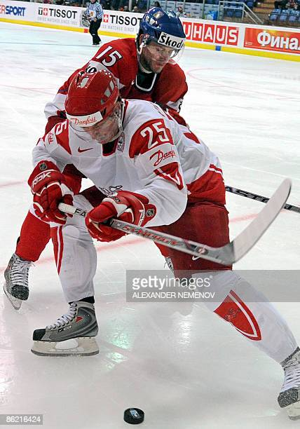 Danish Kasper Pedersen vies with Czech Jan Marek during their preliminary round group D game of the IIHF Internetional Ice Hockey World Championship...