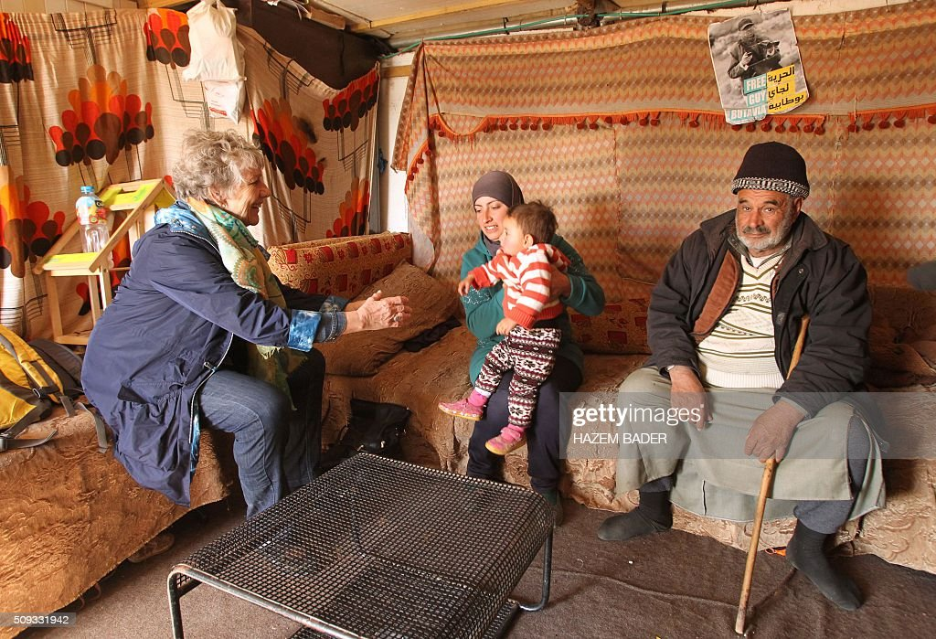 Danish Margrete Auken (L), a member of the European Parliament, talks to a Palestinian family during a visit by a delegation of European MPs to the Palestinian village of Susya, south-east of Hebron, in the Israeli-occupied West Bank, on February 10, 2016. Israel's High Court ruled in May 2015 that Susya's 340 residents could be relocated and its structures demolished, which Human Rights Watch derided as 'a grave breach' of Israel's obligations to the Palestinian populace under its military rule. / AFP / HAZEM BADER
