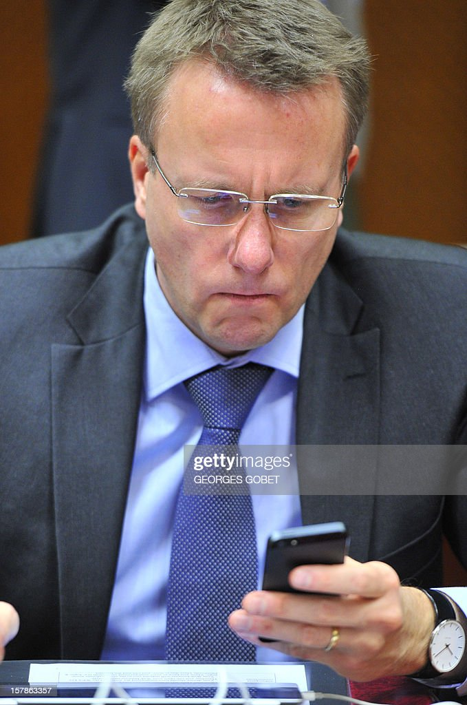 Danish Minister of Justice Morten Bodskov looks at a mobile phone prior a Justice and Home Affairs Council on December 7, 2012 at the EU Headquarters in Brussels. Justice ministers will be called on to agree a general approach on three legislative proposals as a directive establishing minimum rules for criminal sanctions for the most serious market abuse offences, namely insider dealing and market manipulation ('market abuse directive'), a directive on the freezing and confiscation of proceeds of crime in the EU. The proposal aims to make it easier for national authorities to confiscate and recover the profits that criminals make from cross-border and organised crime, a regulation on mutual recognition of protection measures in civil matters upon request of the person at risk , aimed at strengthening the rights of victims. AFP PHOTO GEORGES GOBET