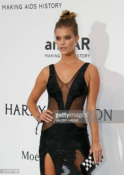 Danish model Nina Agdal poses as she arrives for the amfAR 22st Annual Cinema Against AIDS during the 68th Cannes Film Festival at Hotel du...