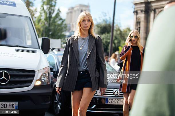 Danish model Ulrikke Hoyer wears a gray striped blazer and a gray tshirt tucked into black denim shorts after the Lanvin show on September 28 2016 in...