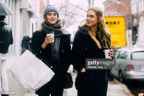 Danish models Mathilde Brok Brandi and Line Brems drink coffee after the Rodarte show during New York Fashion Week Women's Fall/Winter 2016 on...
