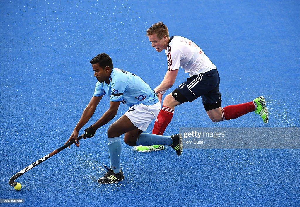 Danish Mujtaba of India and Ian Sloan of Great Britain in action during day two of the FIH Men's Hero Hockey Champions Trophy 2016 match between...