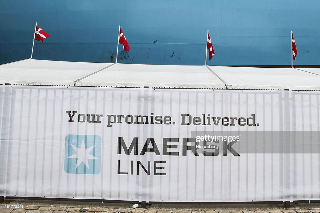 Danish national flags fly above a temporary shelter reading 'Maersk Line. Your Promise. Delivered' during an open day at the Majestic Maersk Triple E class ship, one of the world's largest vessels, operated by A.P. Moeller-Maersk A/S at Langelinie pier in Copenhagen, Denmark, on Tuesday, Sept. 24, 2013. A.P. Moeller-Maersk A/S says it won't cut its investment in developing markets from Asia to South America even as creditors turn their backs. Photographer: Freya Ingrid Morales/Bloomberg via Getty Images