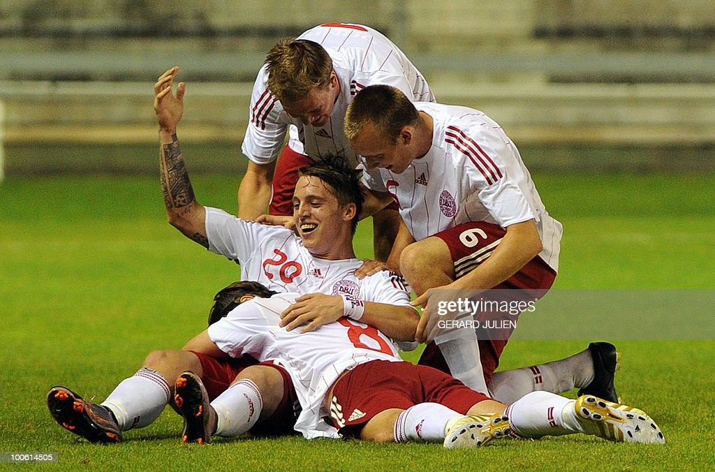 Danish Nicki Bille Nielsen (C) is congratuled after scoring a goal during their Under 21 International Tournament football match France versus Denmark on May 25, 2010 at the Mayol stadium in Toulon, southern France. This is the 38th edition of the event.