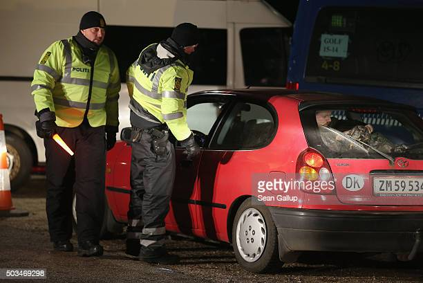 Danish police conducting spot checks on incoming traffic check the documents of the passengers of a car arriving from Germany at the A7 highway...