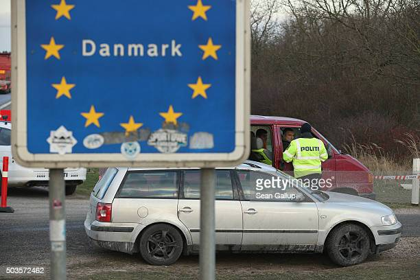Danish police conducting spot checks on incoming traffic check the documents of the passengers of a van arriving from Germany at the A7 highway...